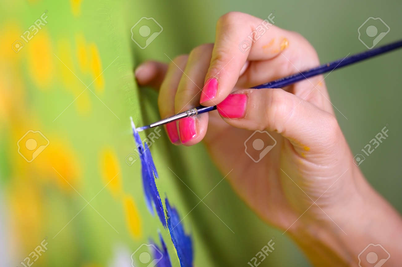 Close-up Shot of Female Artist Hand, Holding Paint Brush and Drawing Oil Painting. Contemporary Painter Creating Modern Abstract Piece of Fine Art. - 170118095