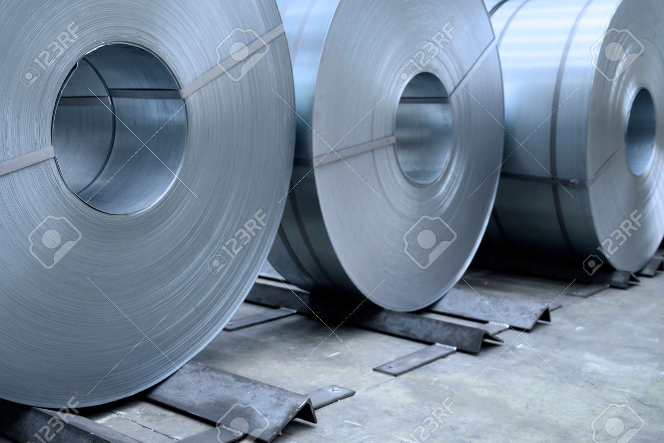 rolls of steel sheet in a plant, galvanized steel coil - 170073896