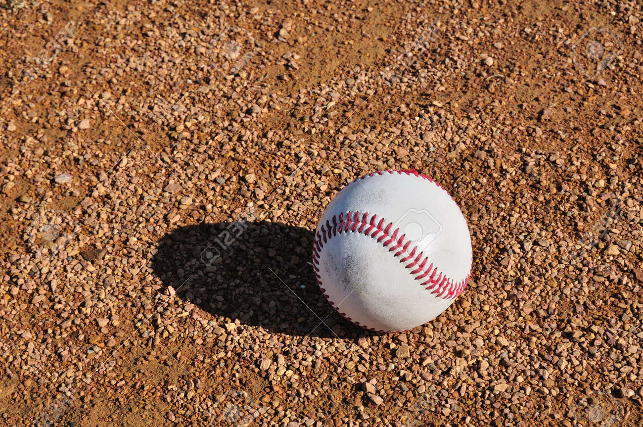 White Baseball on the Infield Dirt Stock Photo - 6911842