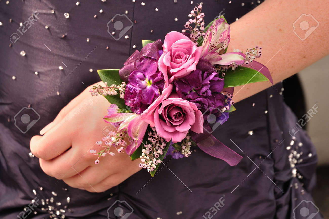 Purple And Pink Flowers Roses On Wrist Corsage For Prom Stock