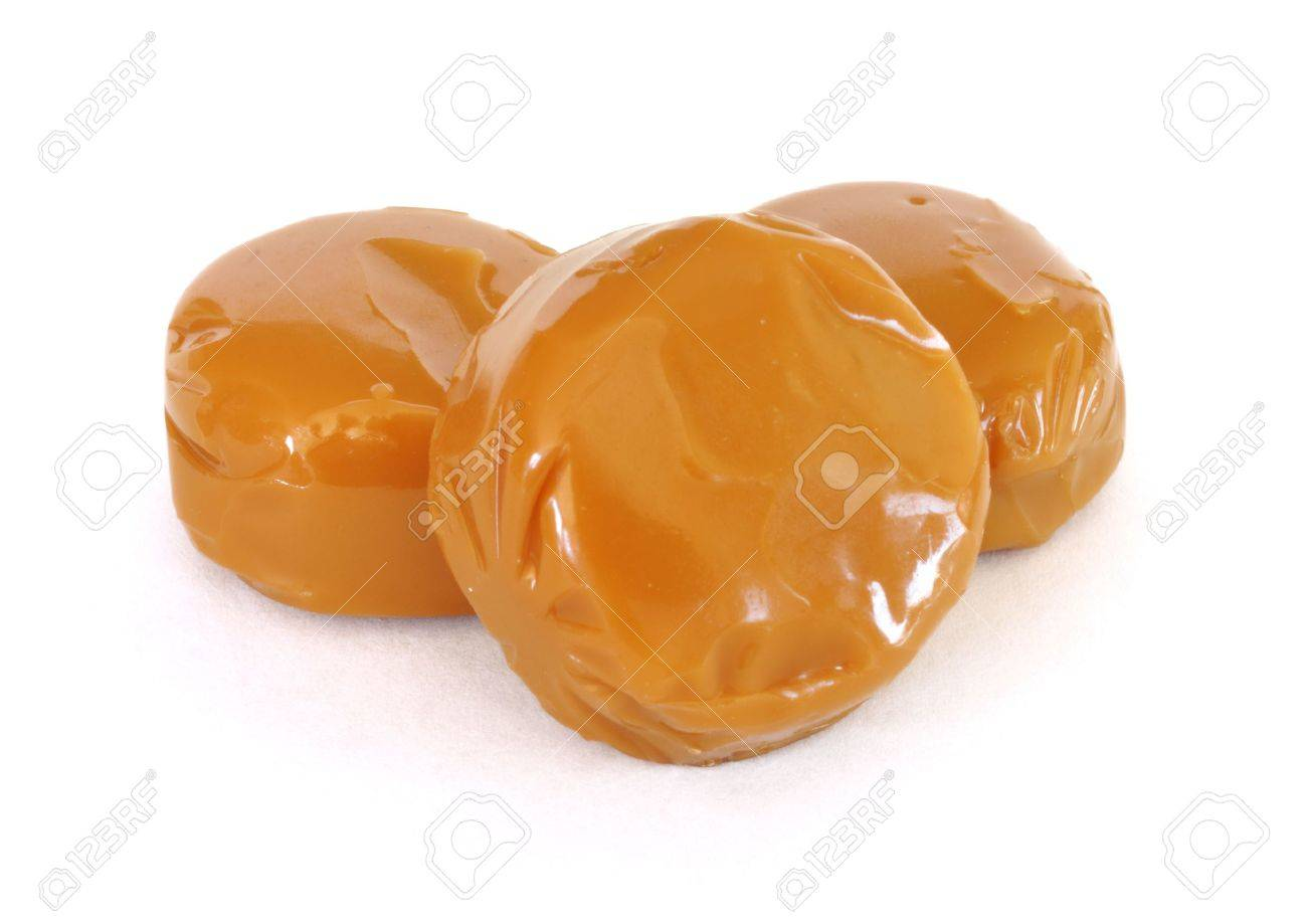 Three Pieces of Caramel Candy Isolated on a White Background Stock Photo - 7093044