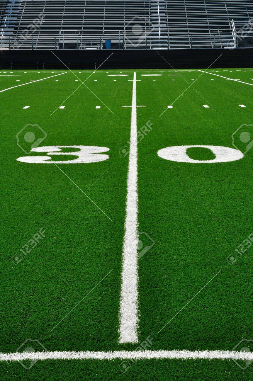 30 Yard Line on American Football Field with Bleachers Stock Photo - 7718594