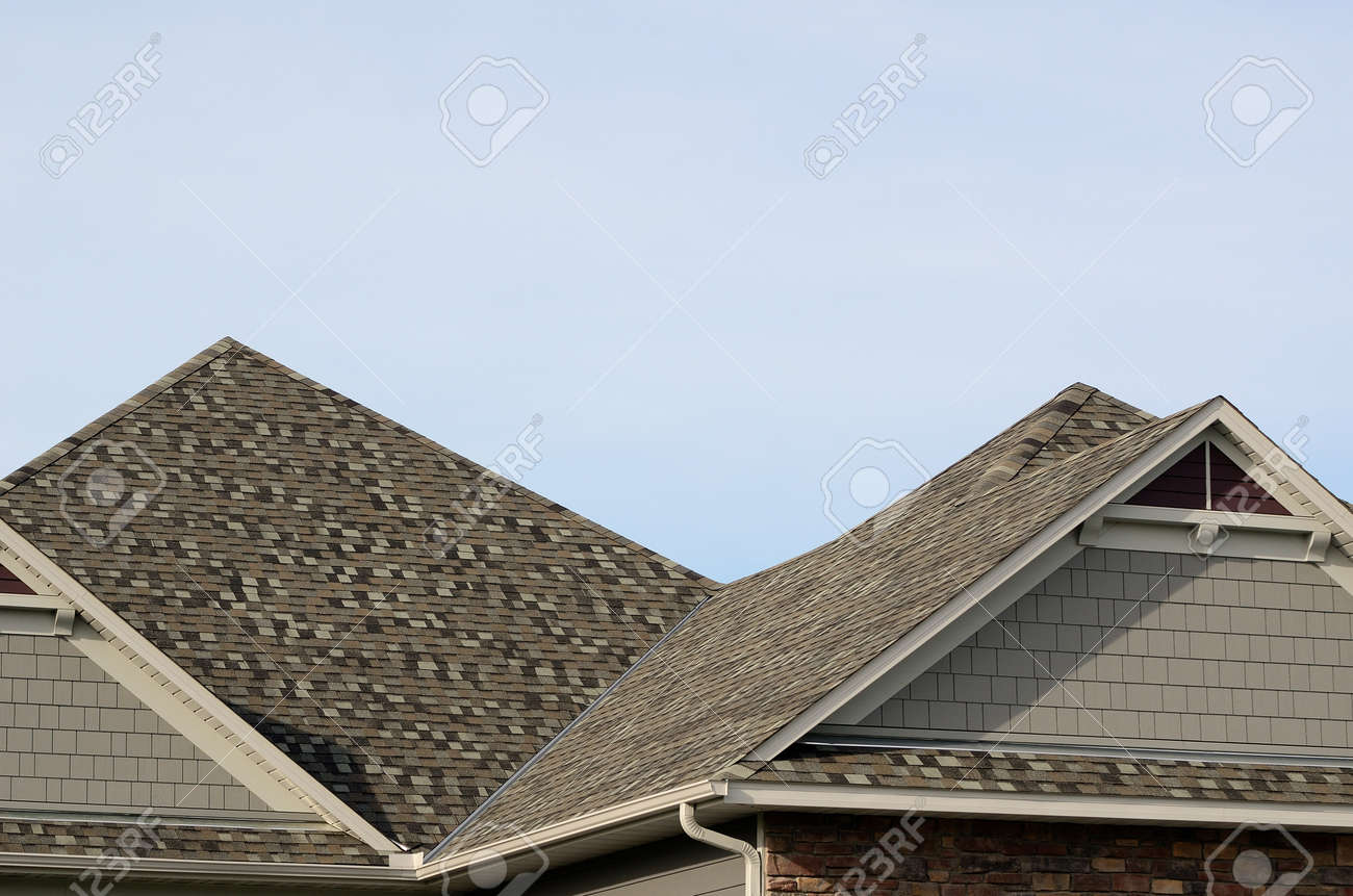 Asphalt Shingles On A Hip Roof With Gable Dormers On A Residential Stock Photo Picture And Royalty Free Image Image 58625739