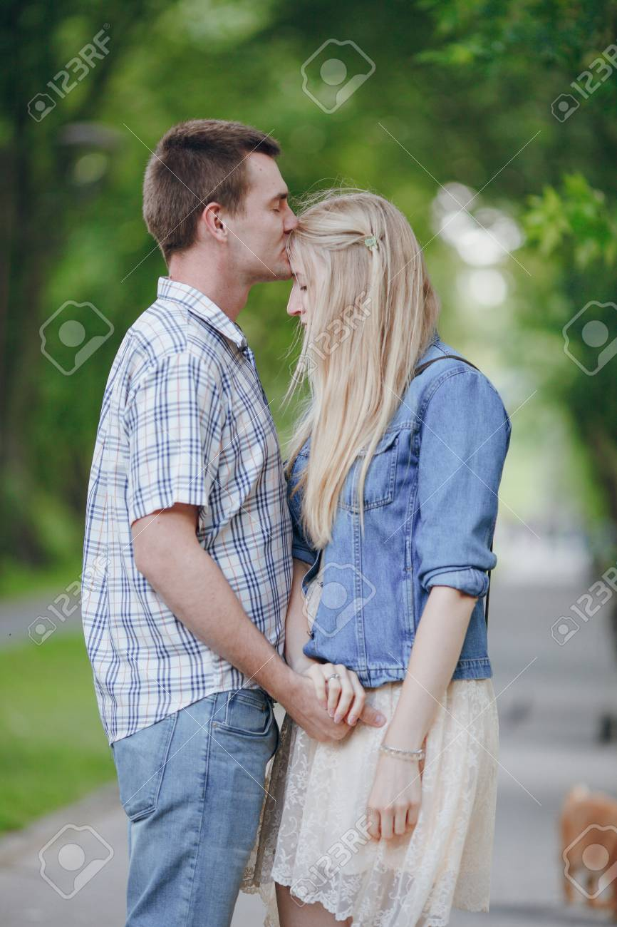 Loving couple walking park kissing hd stock photo 67350931