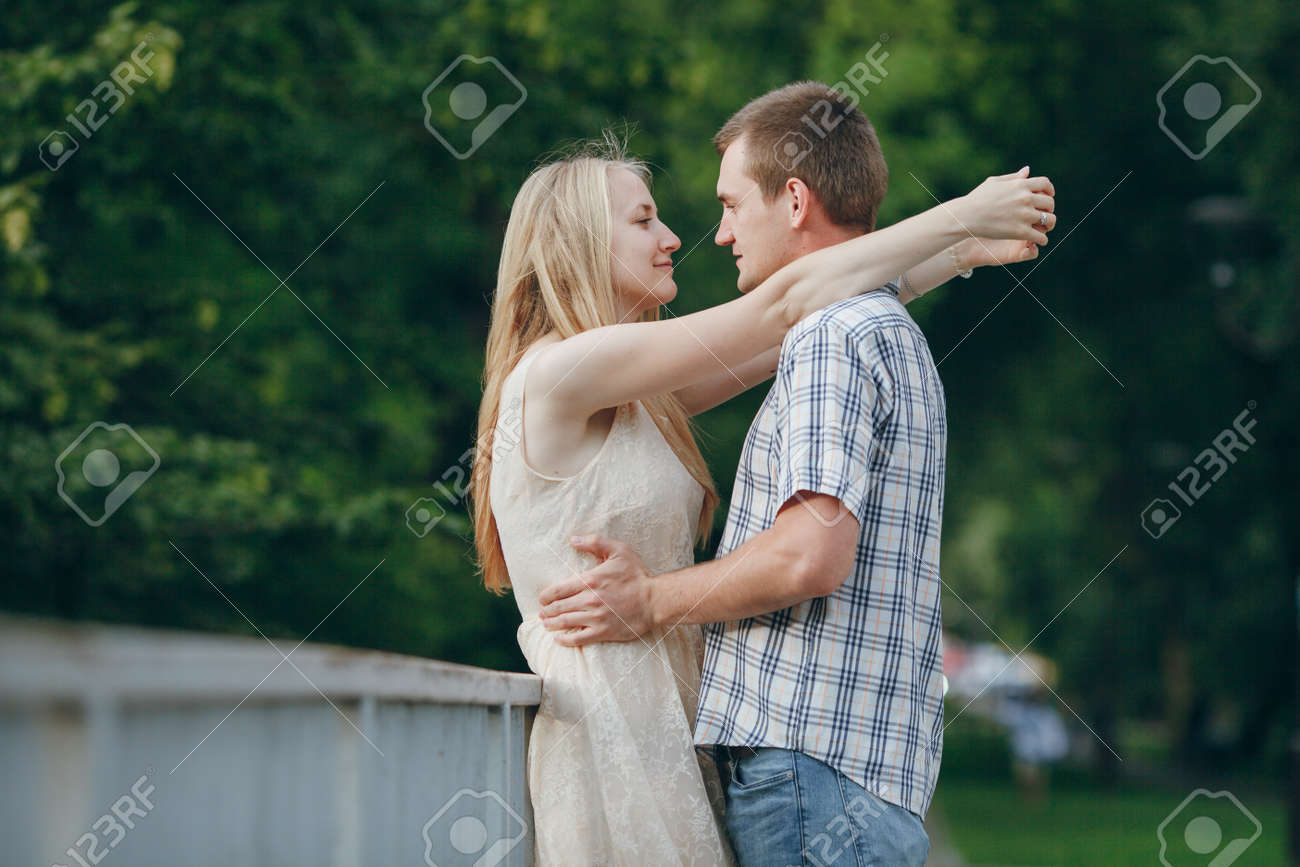 loving couple walking park kissing hd stock photo picture and