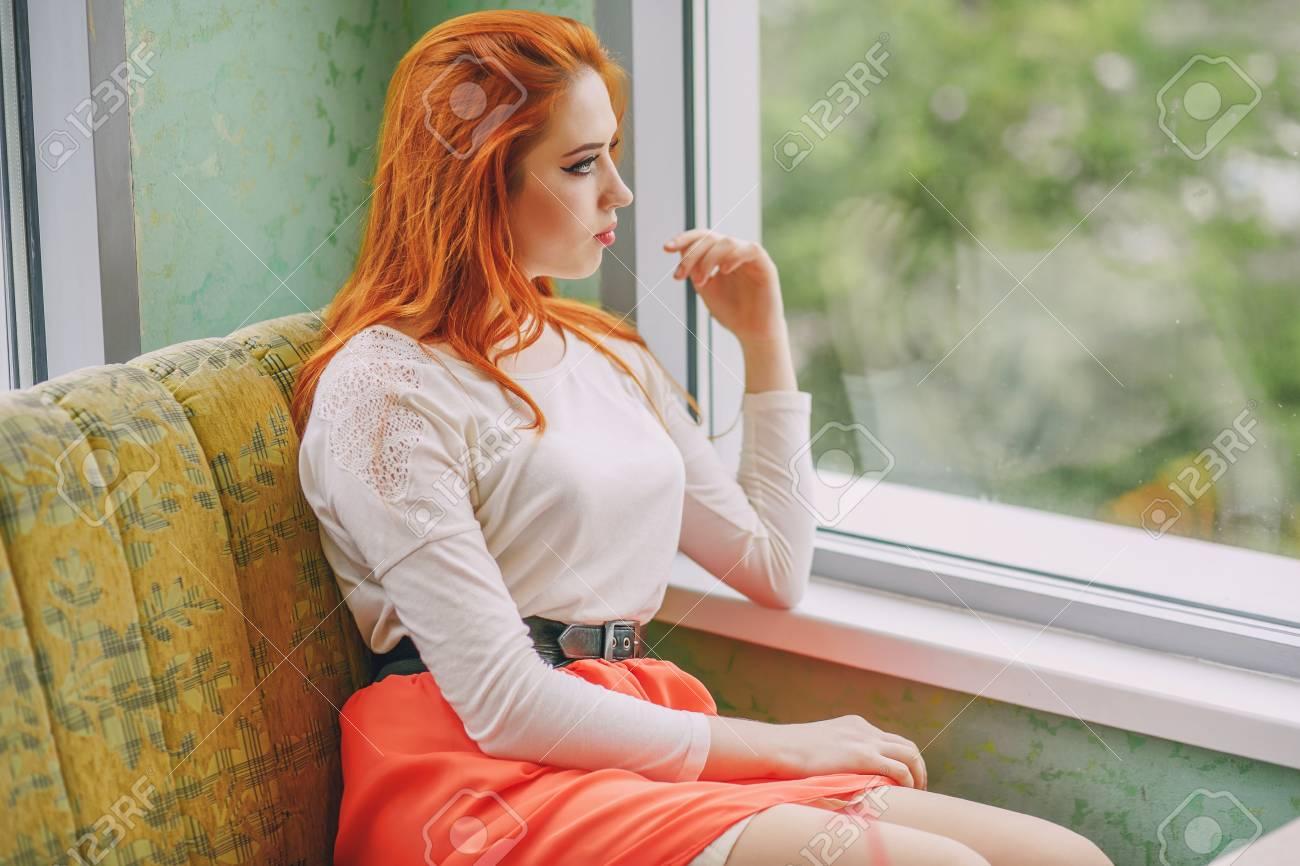 girl near window - 105464927