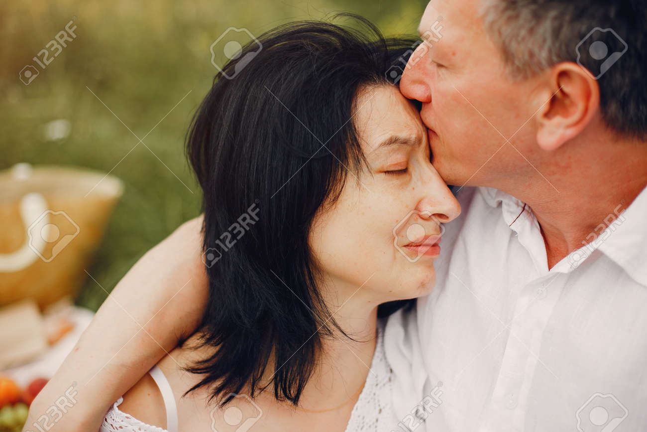 Beautiful adult couple spend time in a summer field - 145017453