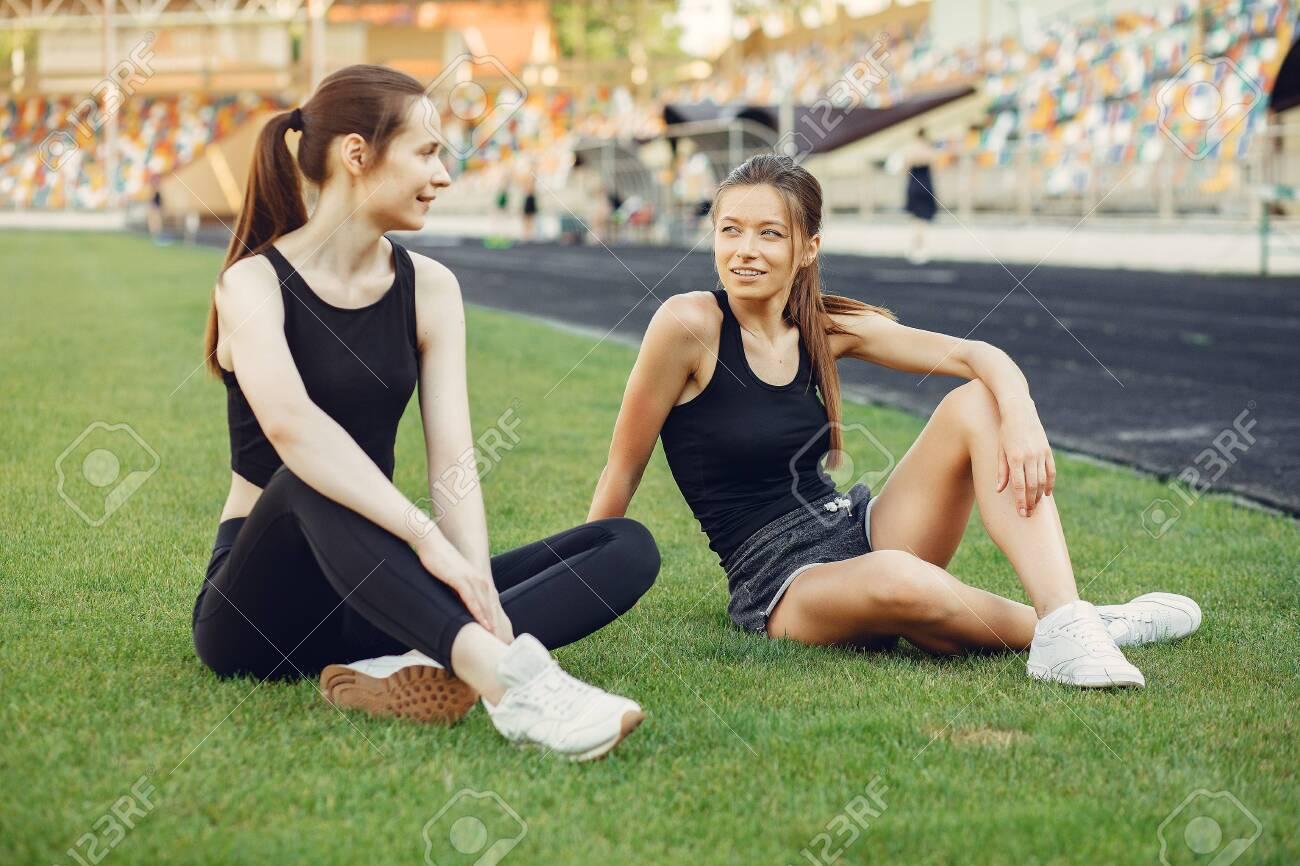 Sports girls training at the stadium - 139456787