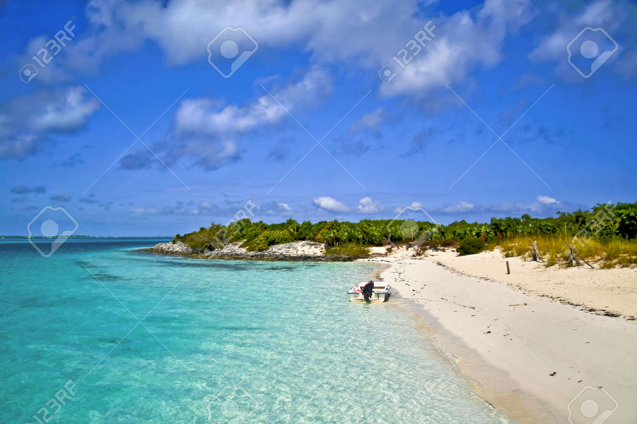 Boat anchored at the point of a beautiful tropical island. Stock Photo - 3076426