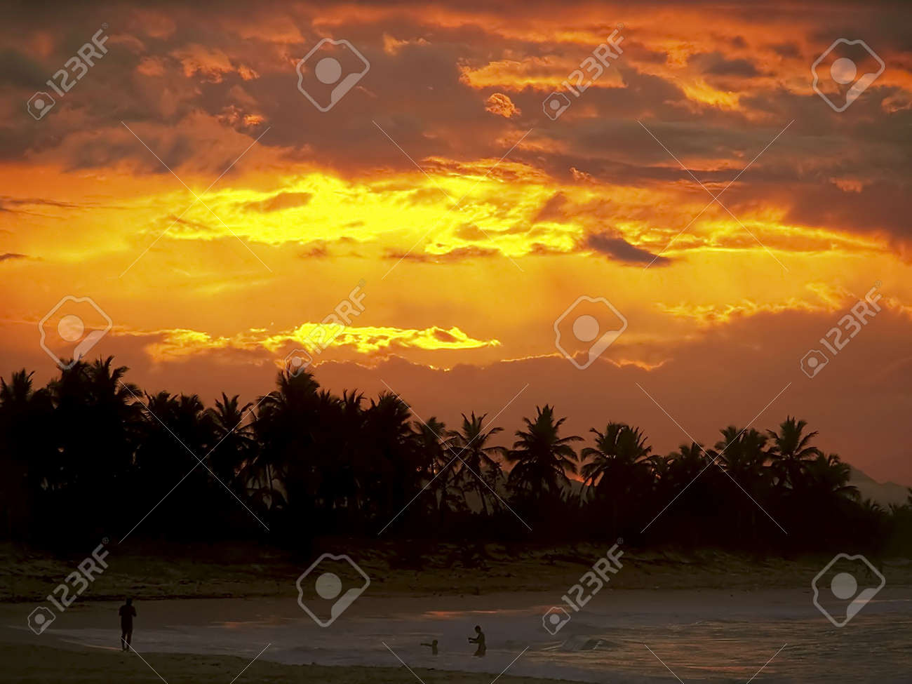 Classic tropical sunset and  playing in the ocean and waves. Stock Photo - 3086545