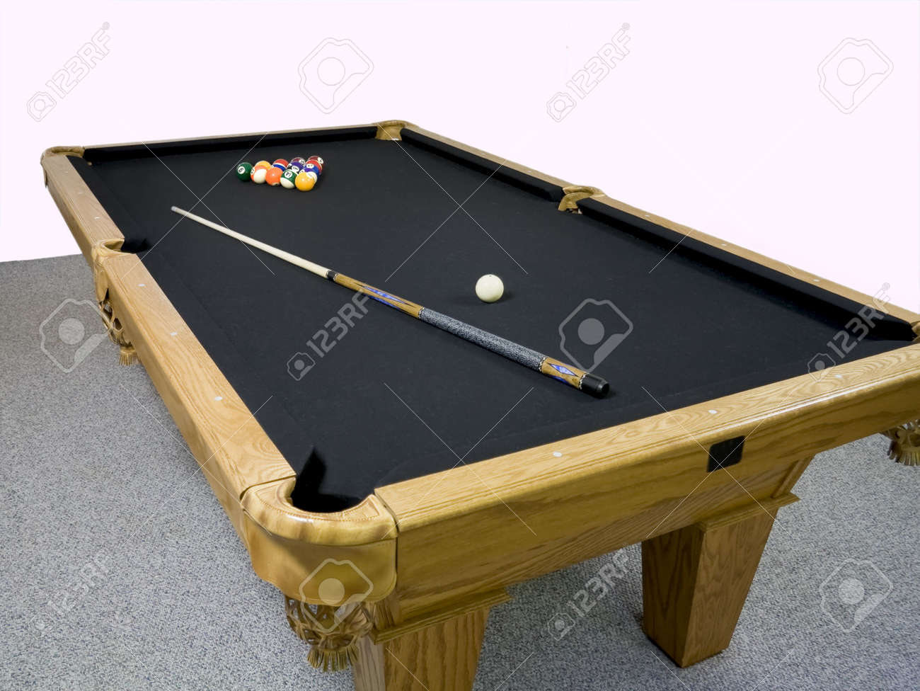Luxury Black Table Top Pool Table With Racked Billiards And Stick Laying On  Top. Stock