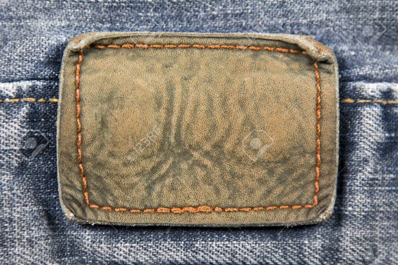 Close up aged blank leather patch on the back of a pair of jeans. - 4350020