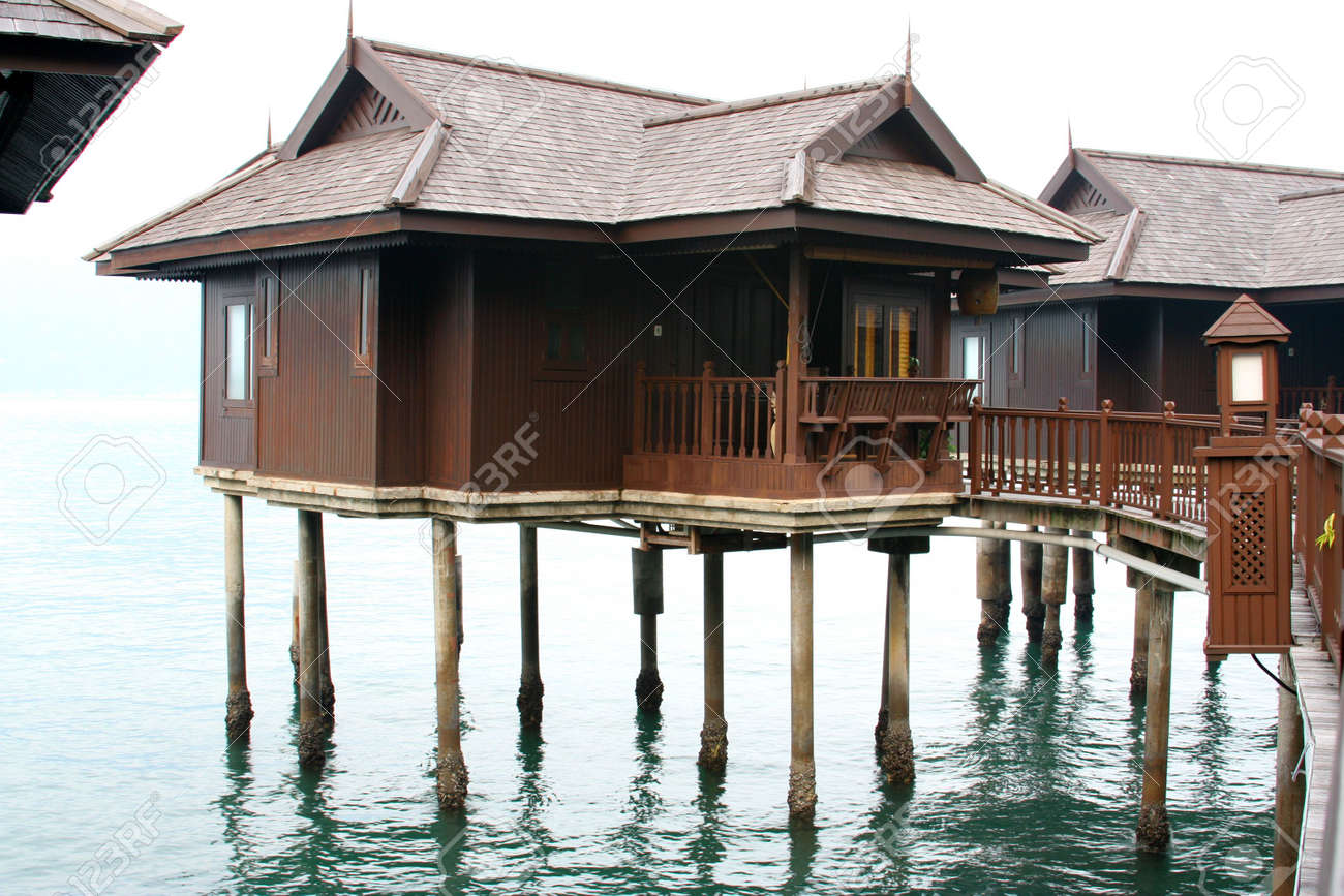Beautiful beach resort with white sandy beaches and water huts. Stock Photo - 719460