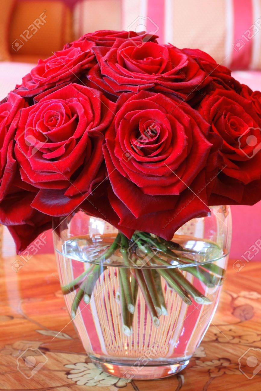 Vase of Roses on Table a Vase Full of Red Roses in a