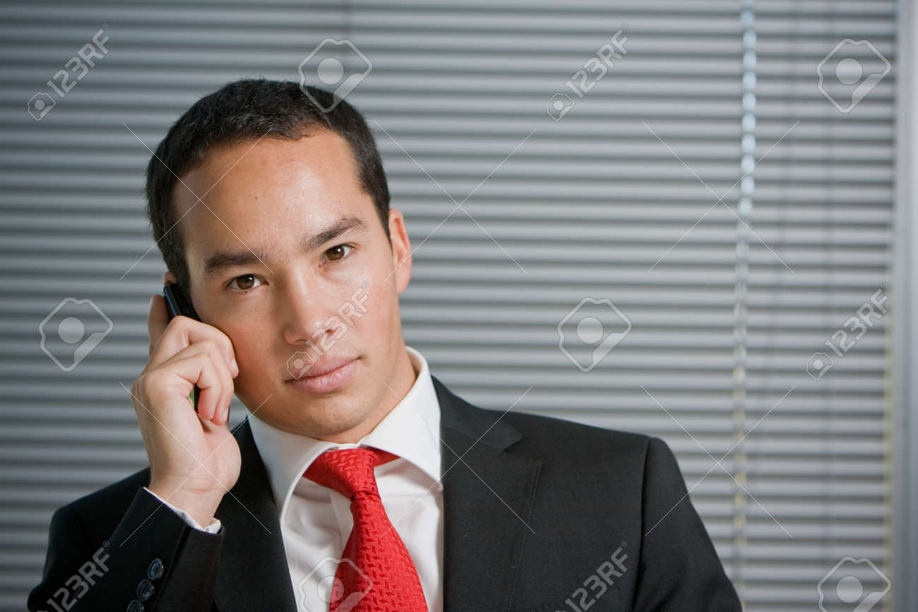 Business man holding a mobile or cell phone Stock Photo - 4026291