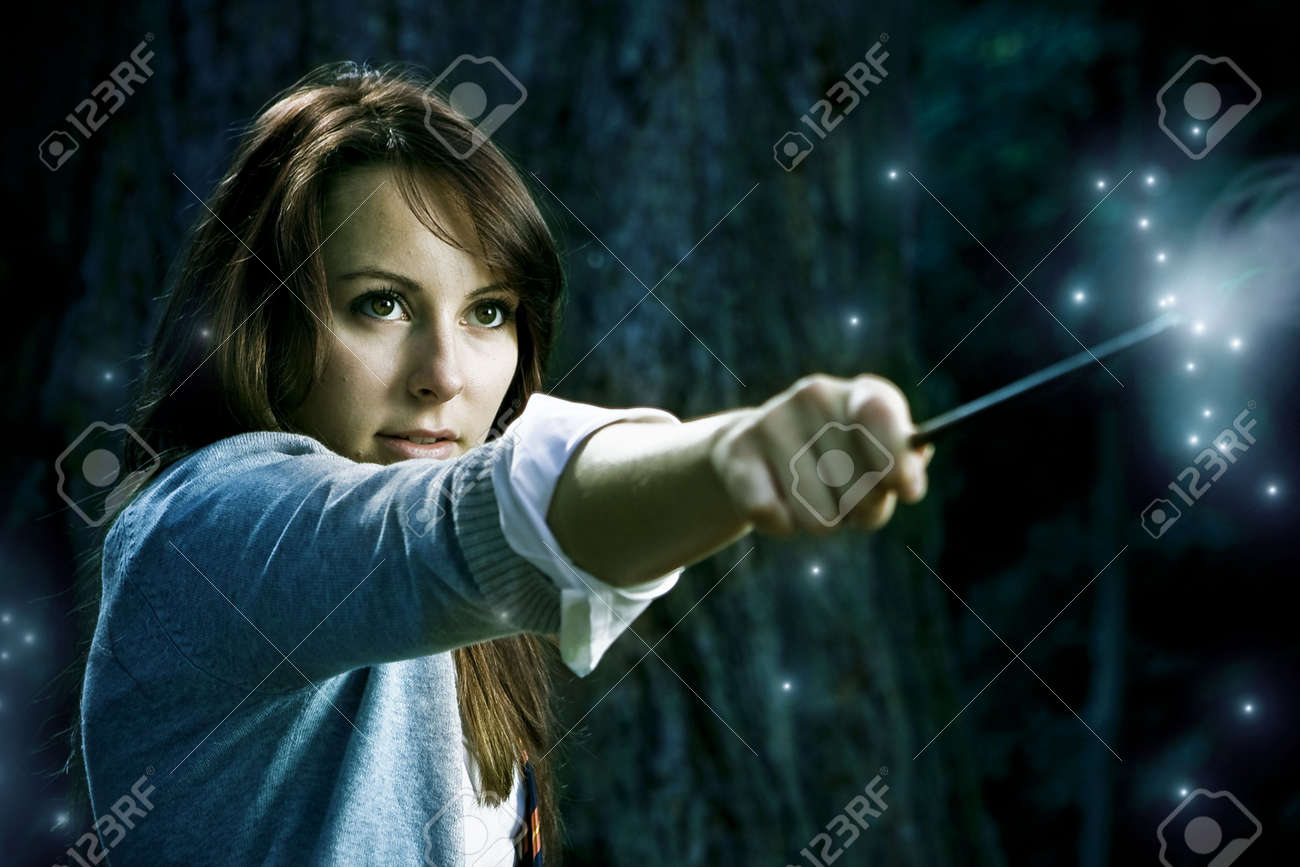 Teenage wizard girl with magic wand casting spells in a enchanted fantasy forest Stock Photo - 6811580