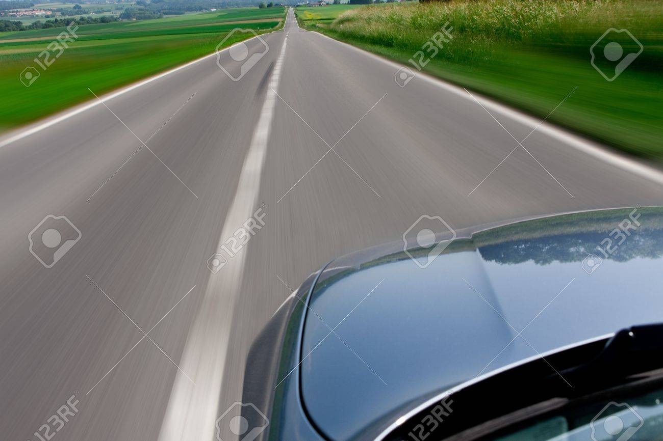 Zooming Car Blue car zooming fast down the