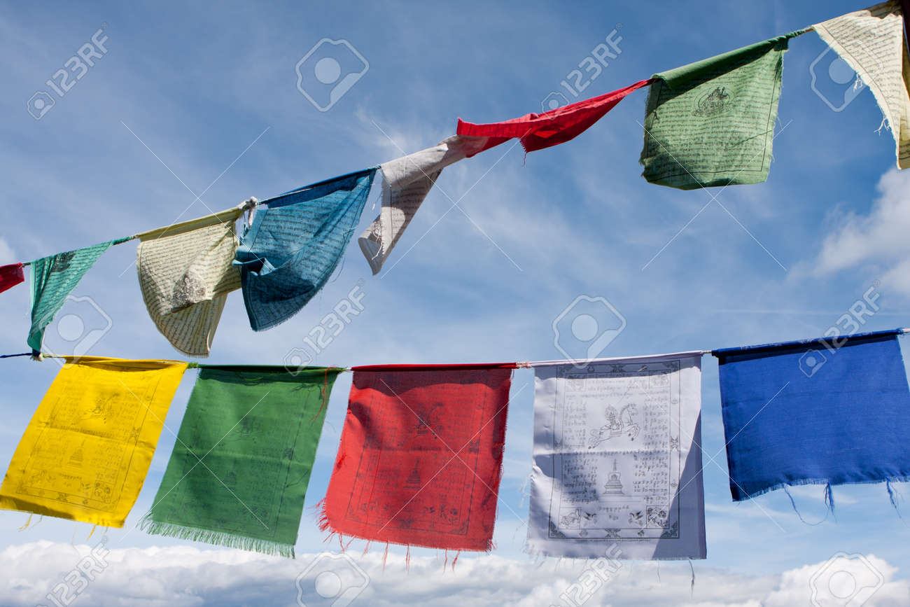 Buddhist tibetan prayer flags flying in the wind against blue sky Stock Photo - 11966402