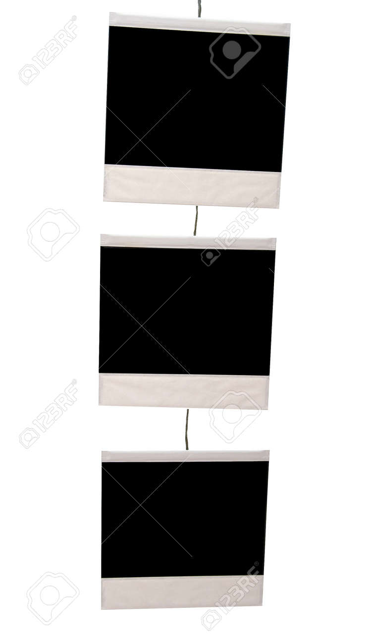 Three Blank Instant Photos Suspended By Very Thin Wire Stock Photo ...