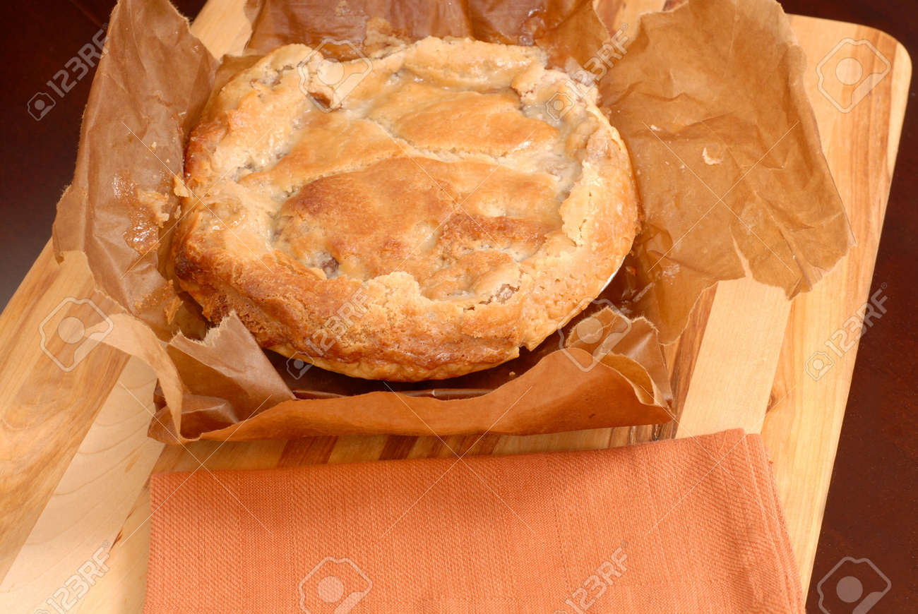 delicious paperbag apple pie on cutting board stock photo picture