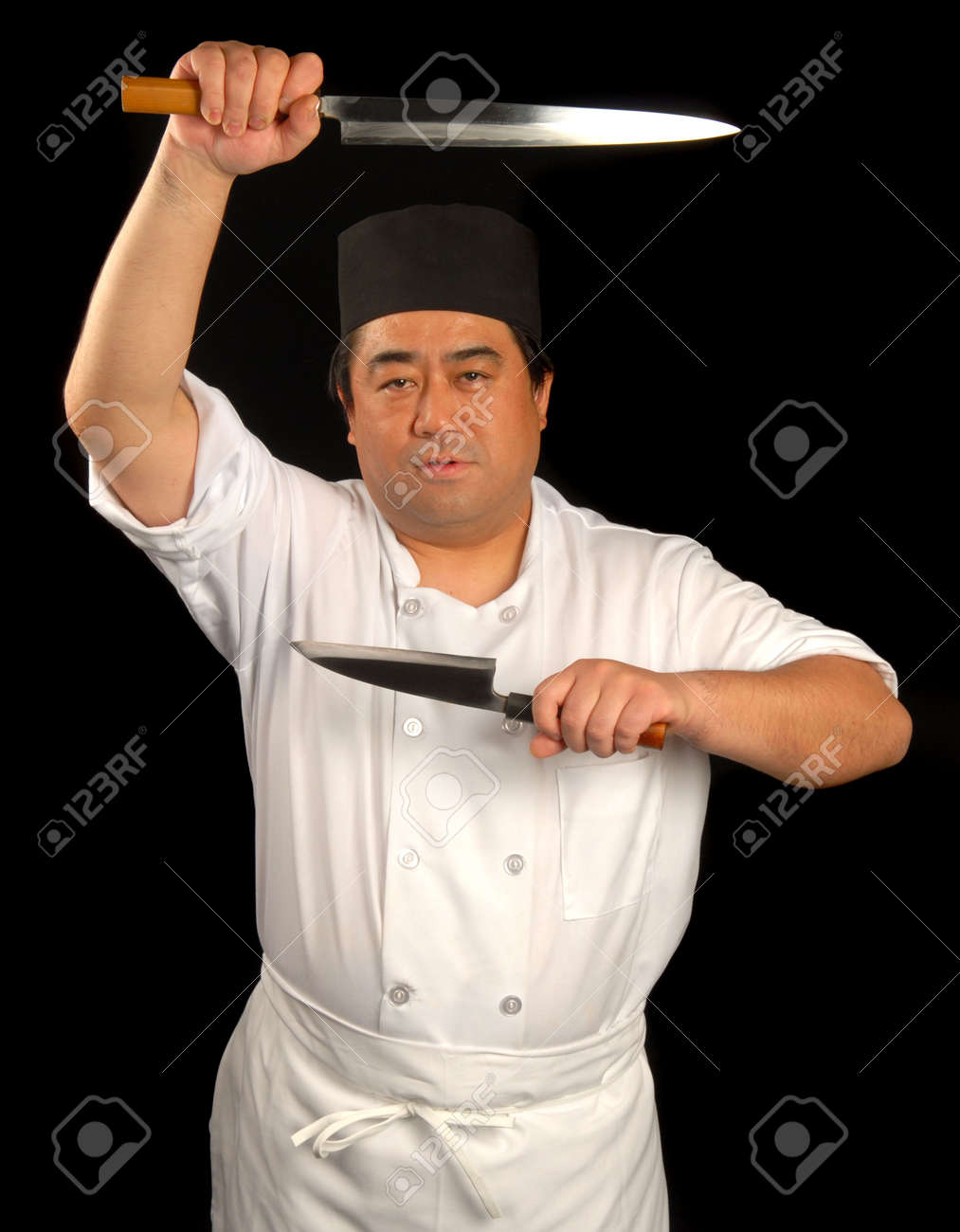 Asian sushi chef posing with his knives Stock Photo - 2701767