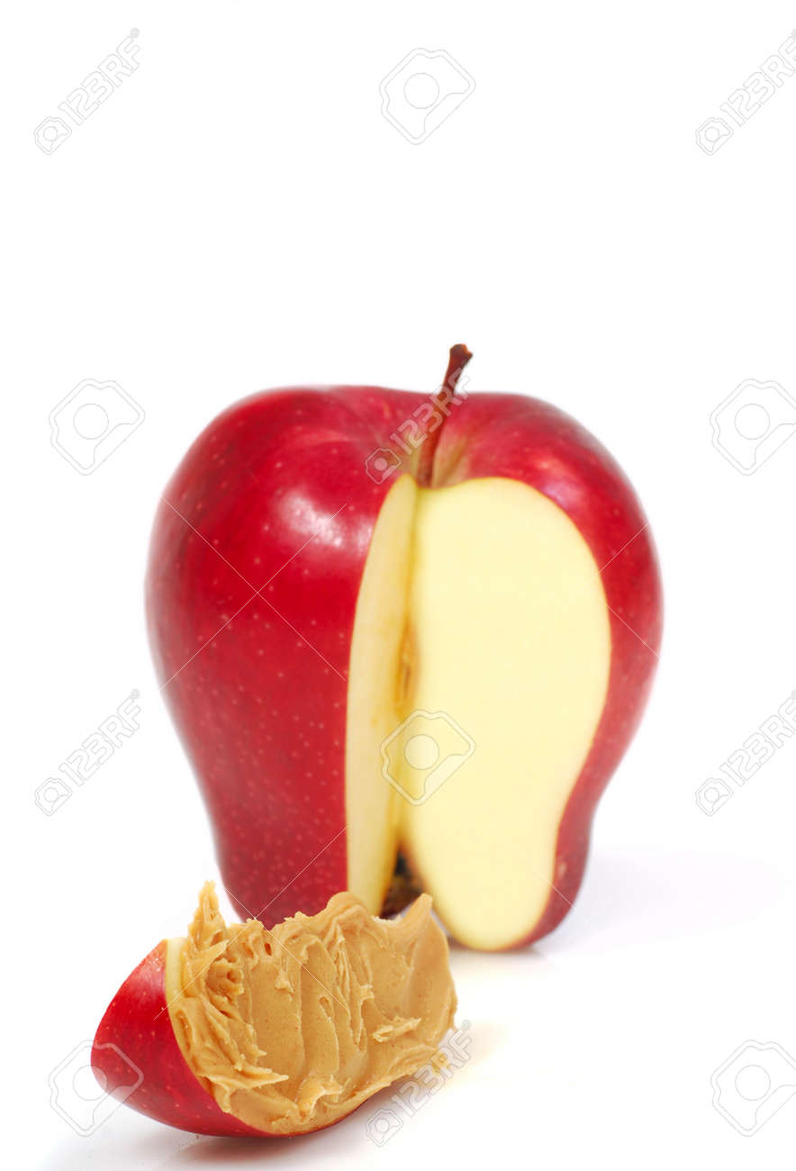 red apple slice. delicious red apple slice with peanut butter spread on it stock photo - 6790635