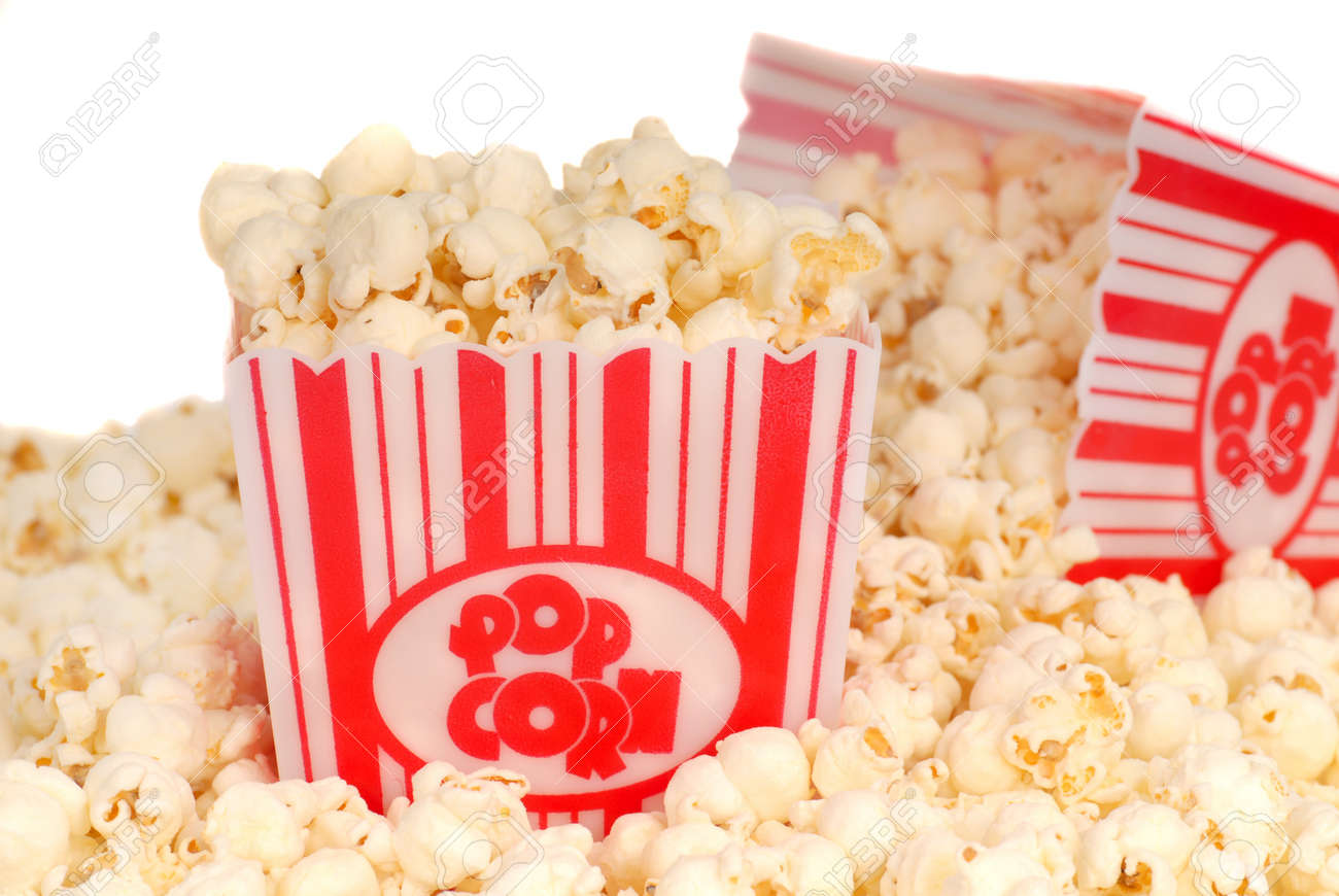 Two boxes of delicious movie popcorn with popcorn spilling out Stock Photo - 9701827