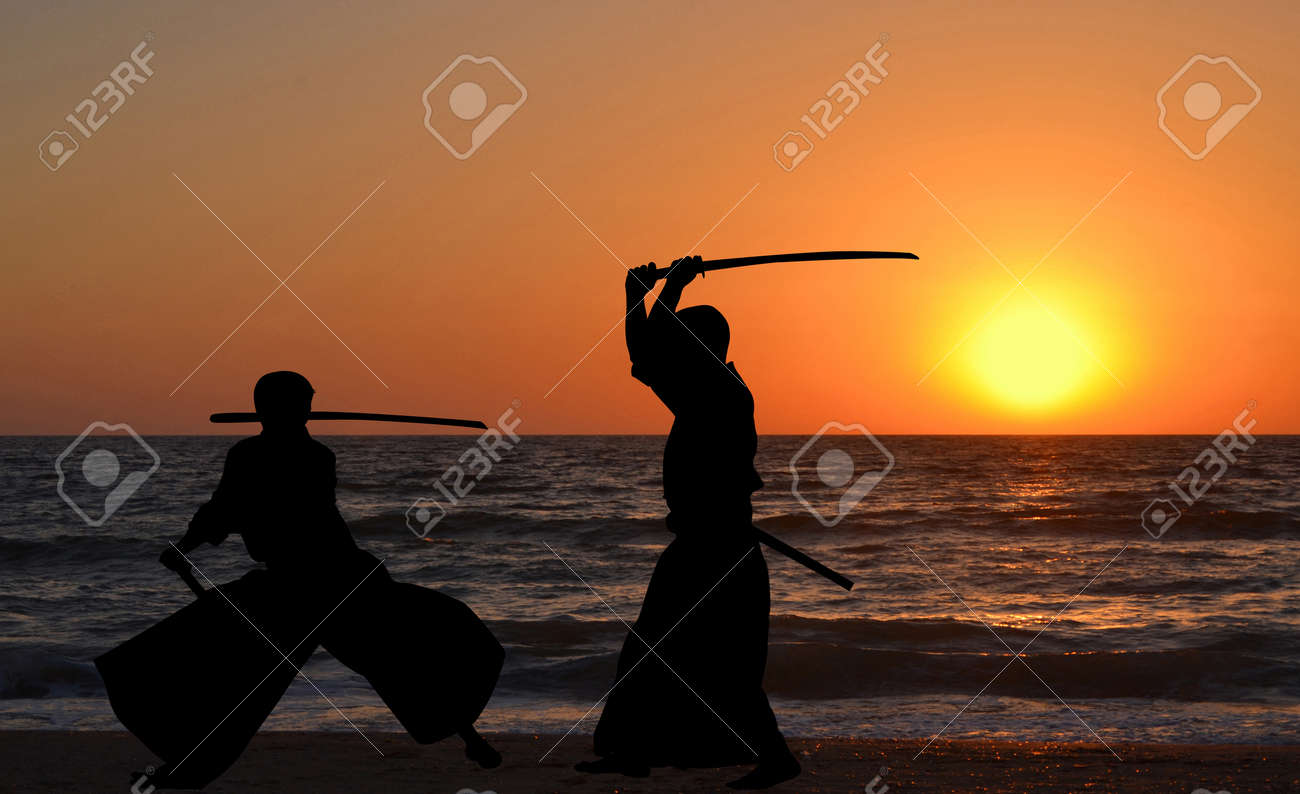 Men silhouettes practicing Aikido at sunrise - 59586854