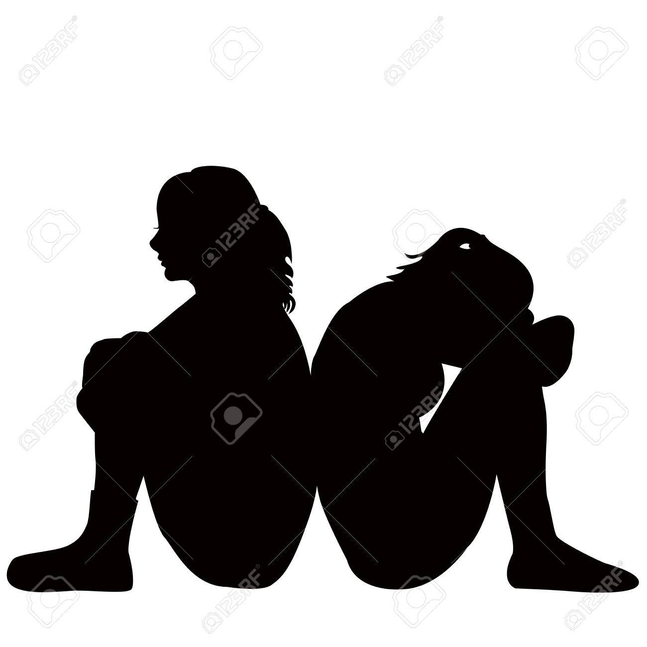 Silhouettes of two young women sitting on the floor - 63299055
