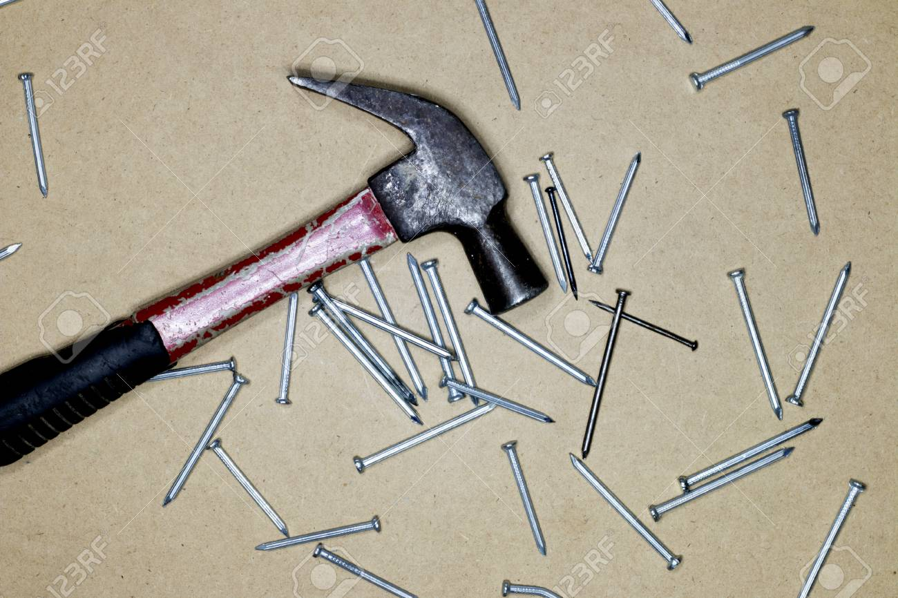 Vintage Old Hammer With Rusty Nails On Wood Table Background Stock ...