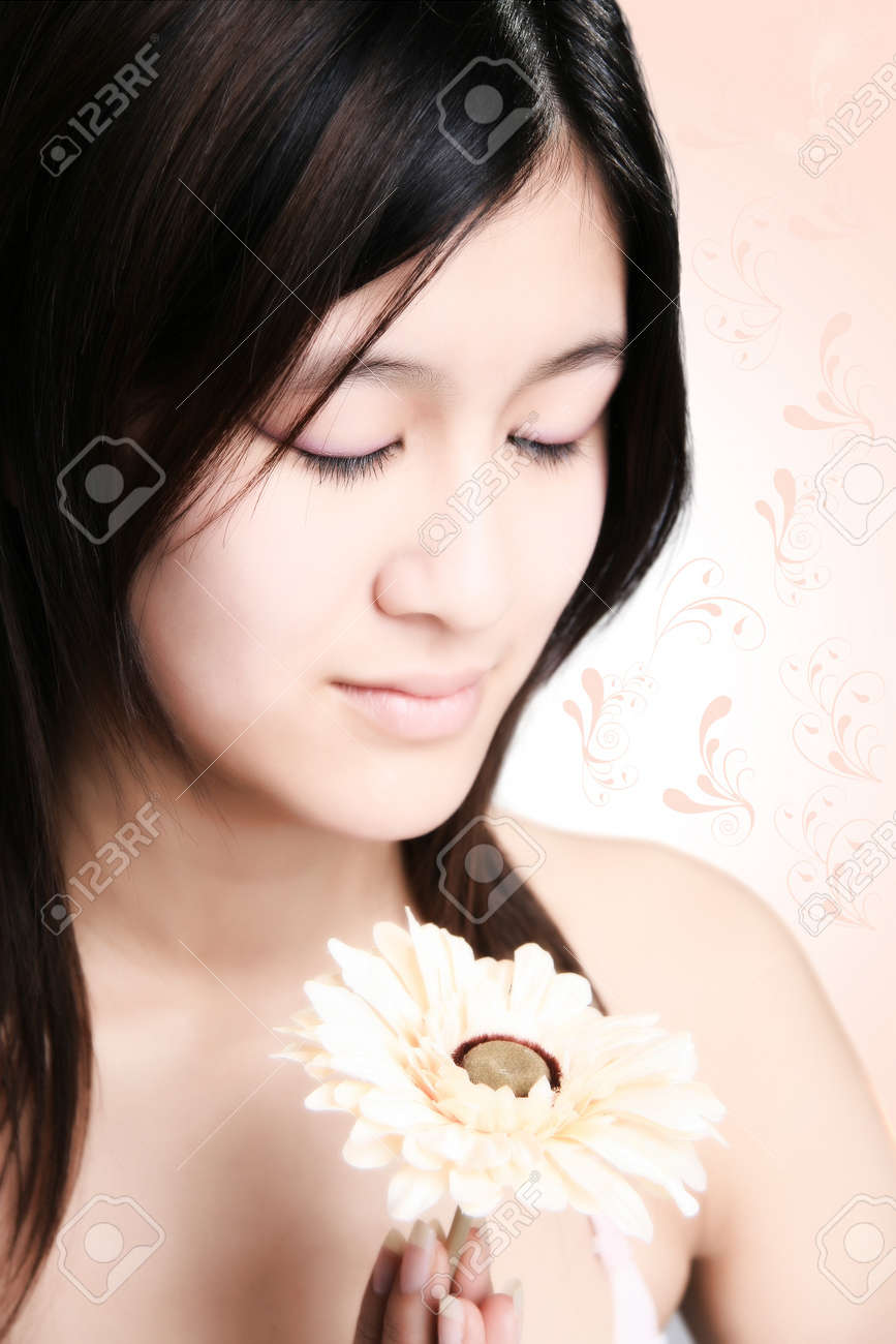 Perfect sweet asian girl with flower is doing meditation and relax Stock Photo - 4193569