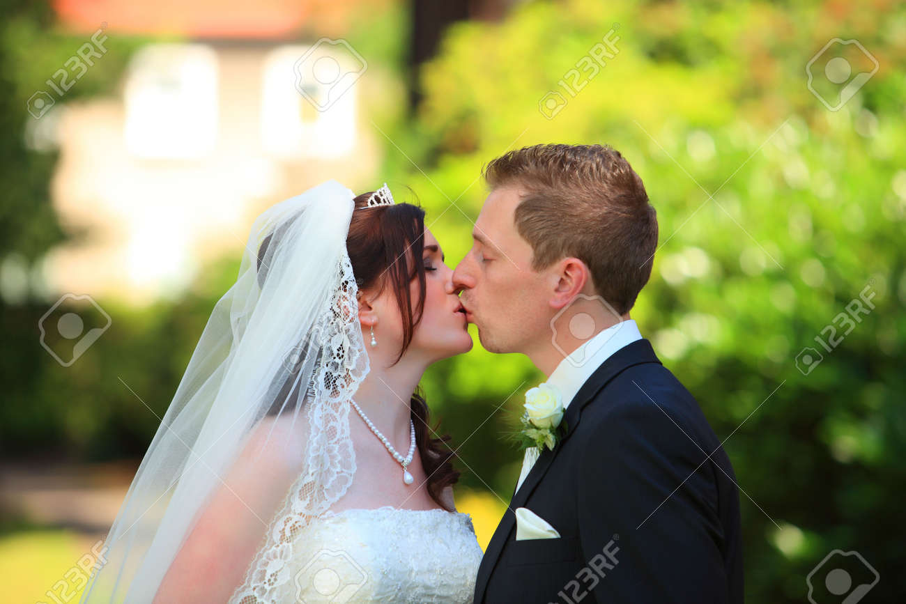 Tender wedding kiss young couple is kissing each other after stock photo tender wedding kiss young couple is kissing each other after wedding wedding kiss junglespirit Images
