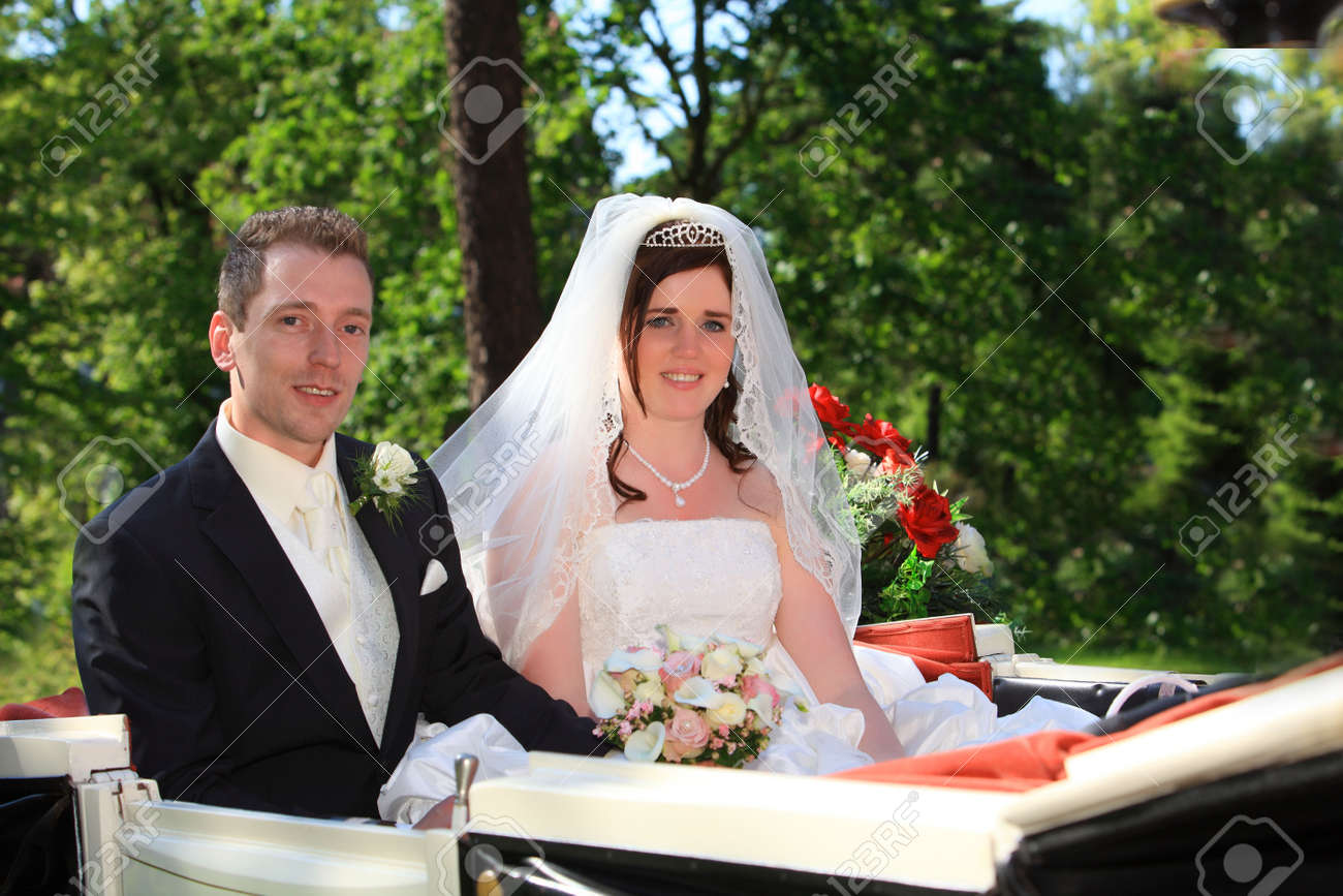 Wedding carriage. young couple after wedding in a nice wedding trailer with horses in front of them Stock Photo - 5135719