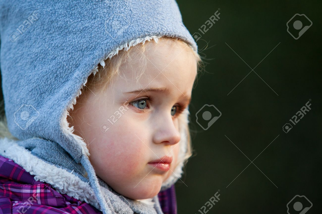 cute nice pretty baby girl with woollen hat in the cold winter