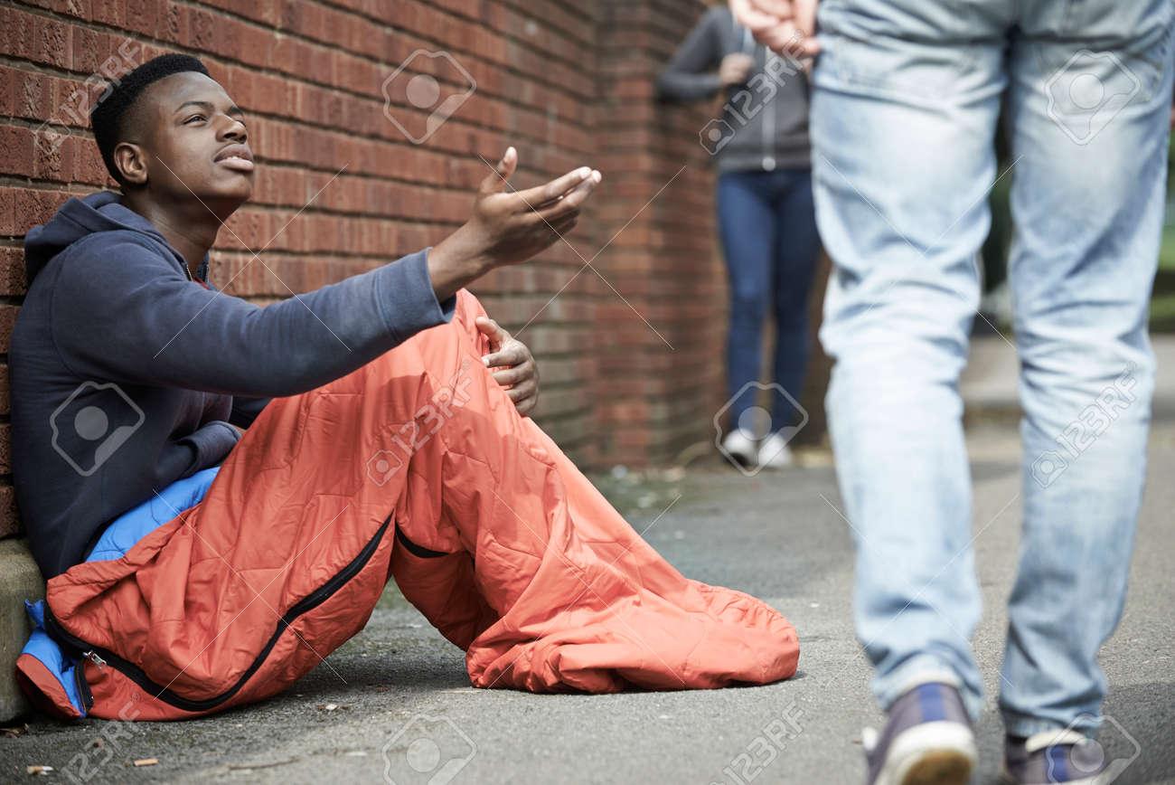 Homeless Teenage Boy Begging For Money On The Street - 43050034