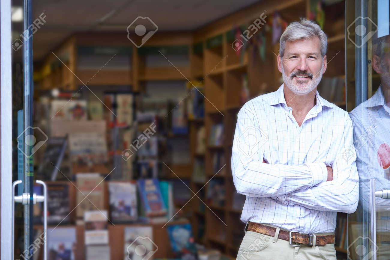 Portrait Of Male Bookshop Owner Outside Store Stock Photo - 45503846