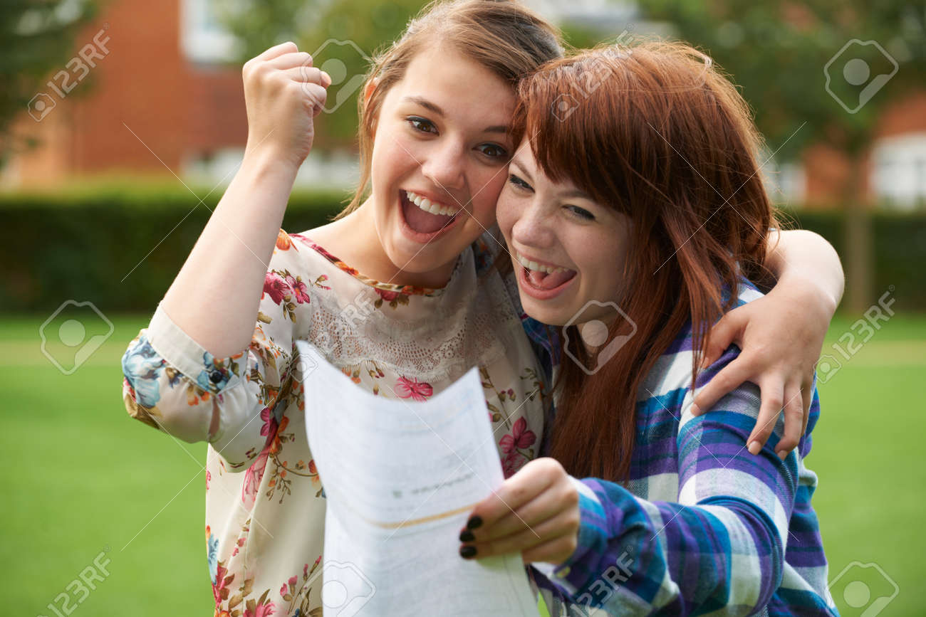 Teenage Girls Celebrating Good Exam Result - 49295833