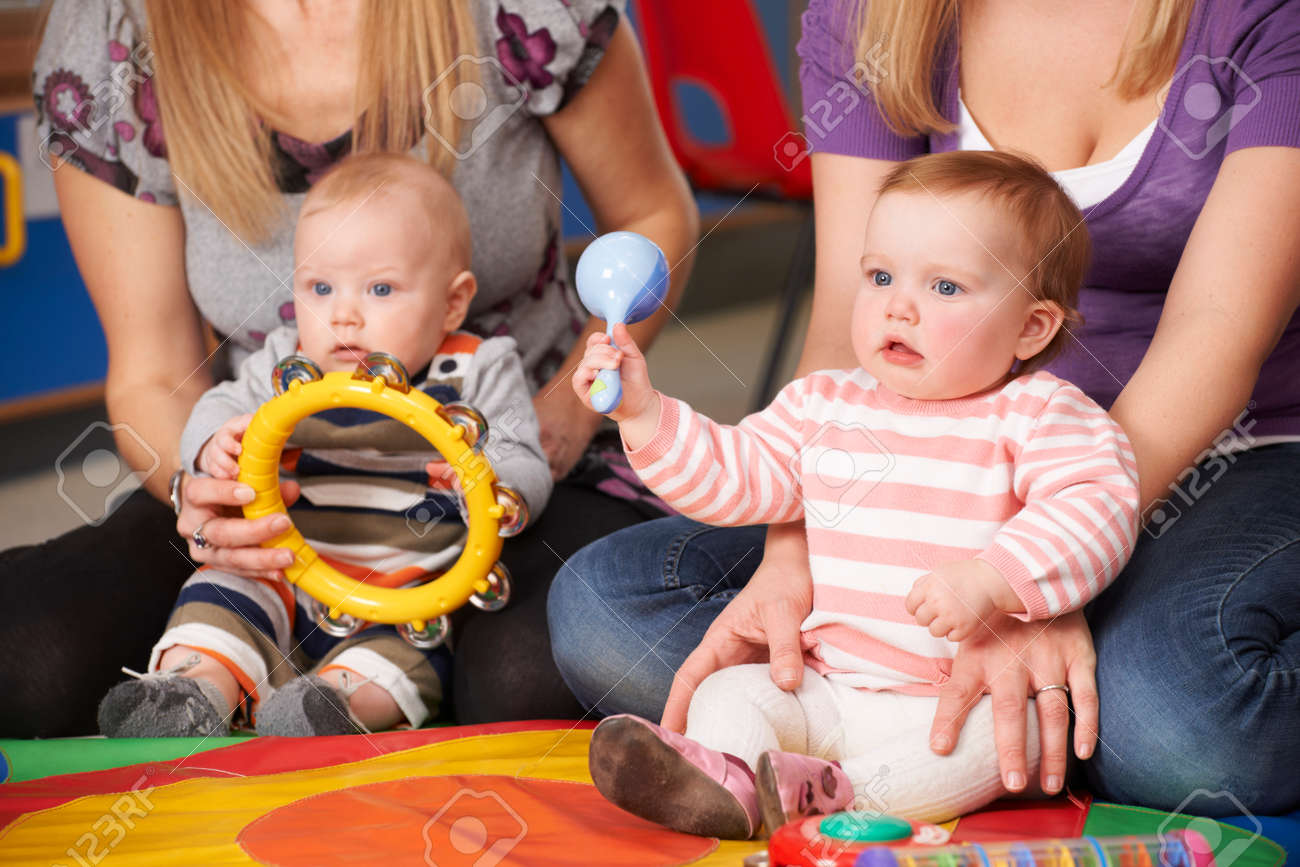 Mothers And Babies At Music Group Stock Photo - 49363754