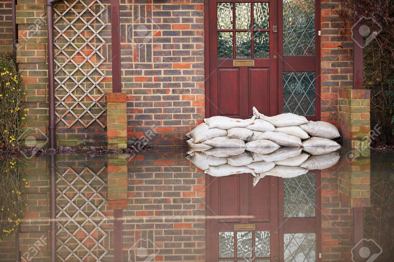 Sandbags Outside Front Door Of Flooded House - 49640689