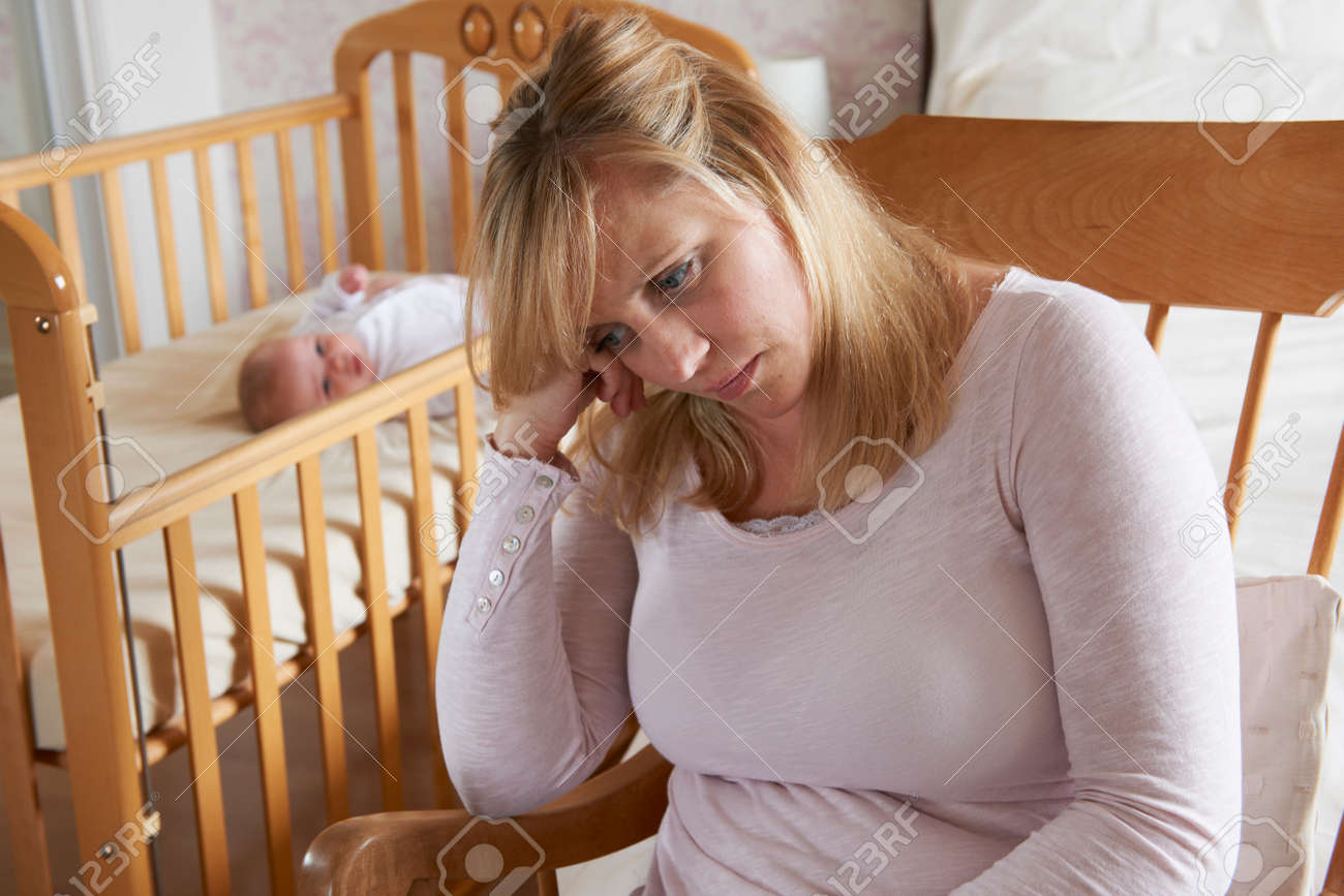 Mother In Nursery Suffering From Post Natal Depression - 50160074