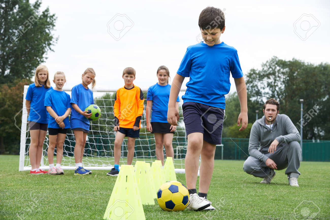 Coach Leading Outdoor Soccer Training Session - 54906574