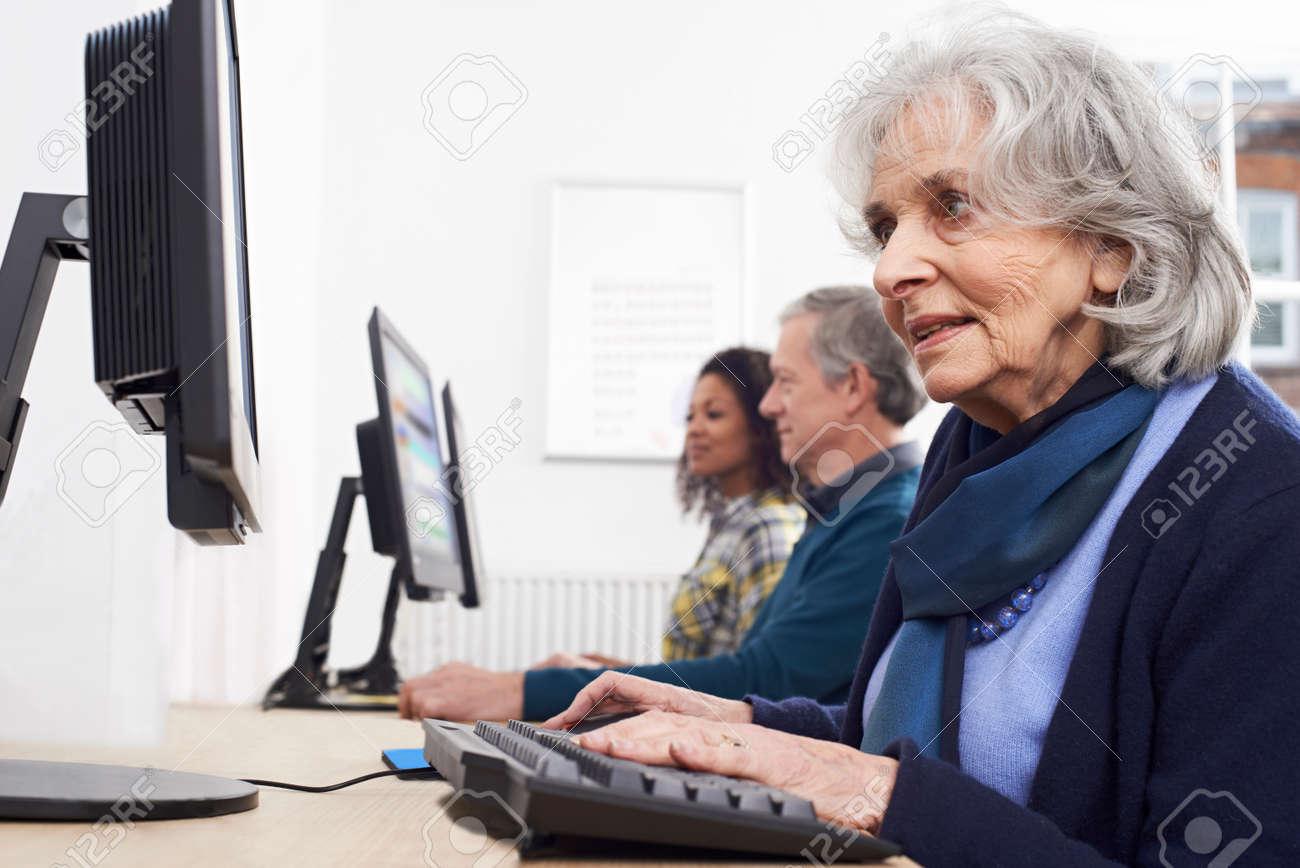 Senior Woman Attending Computer Class - 54906691