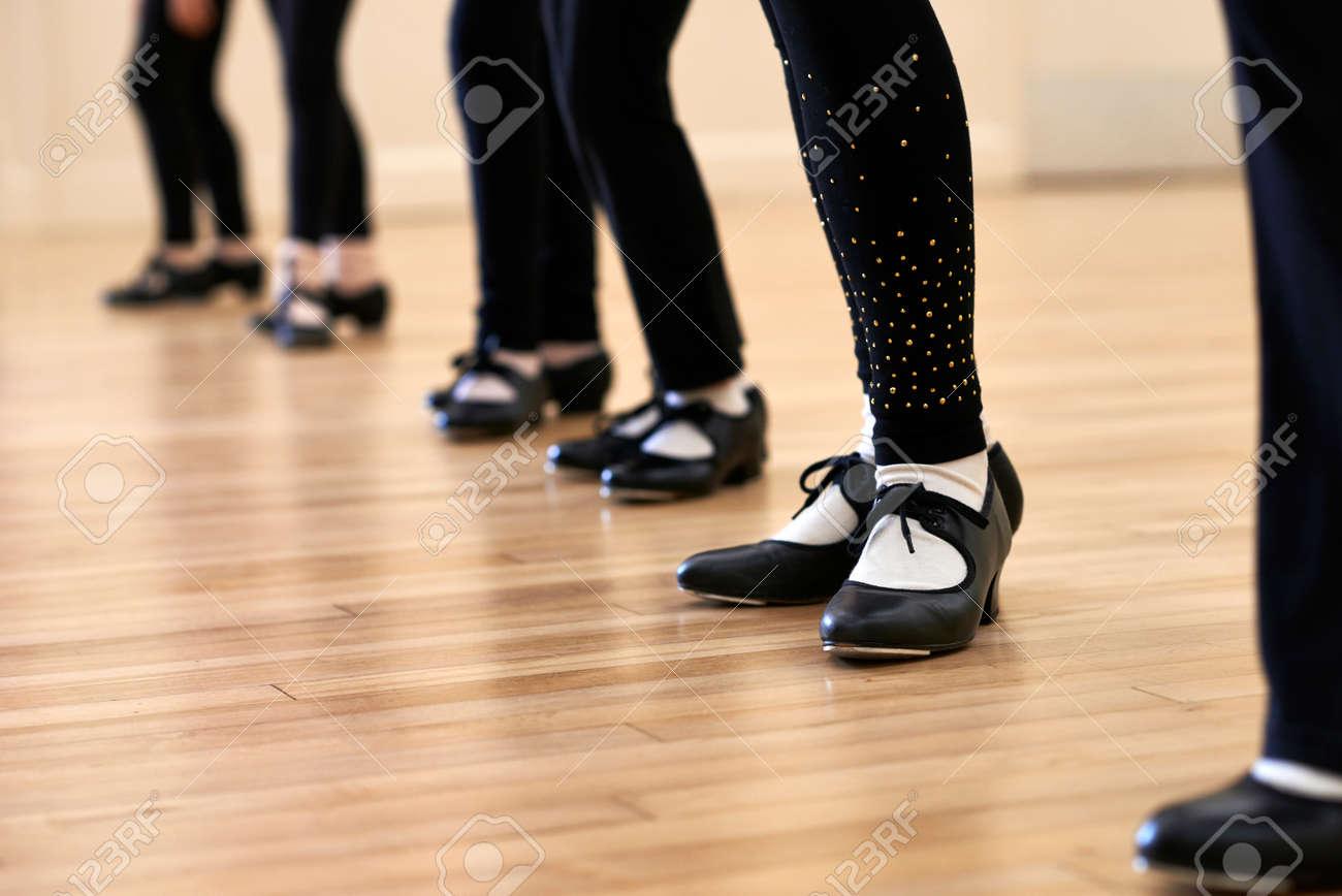 Close Up Of Feet In Children's Tap Dancing Class - 56216399