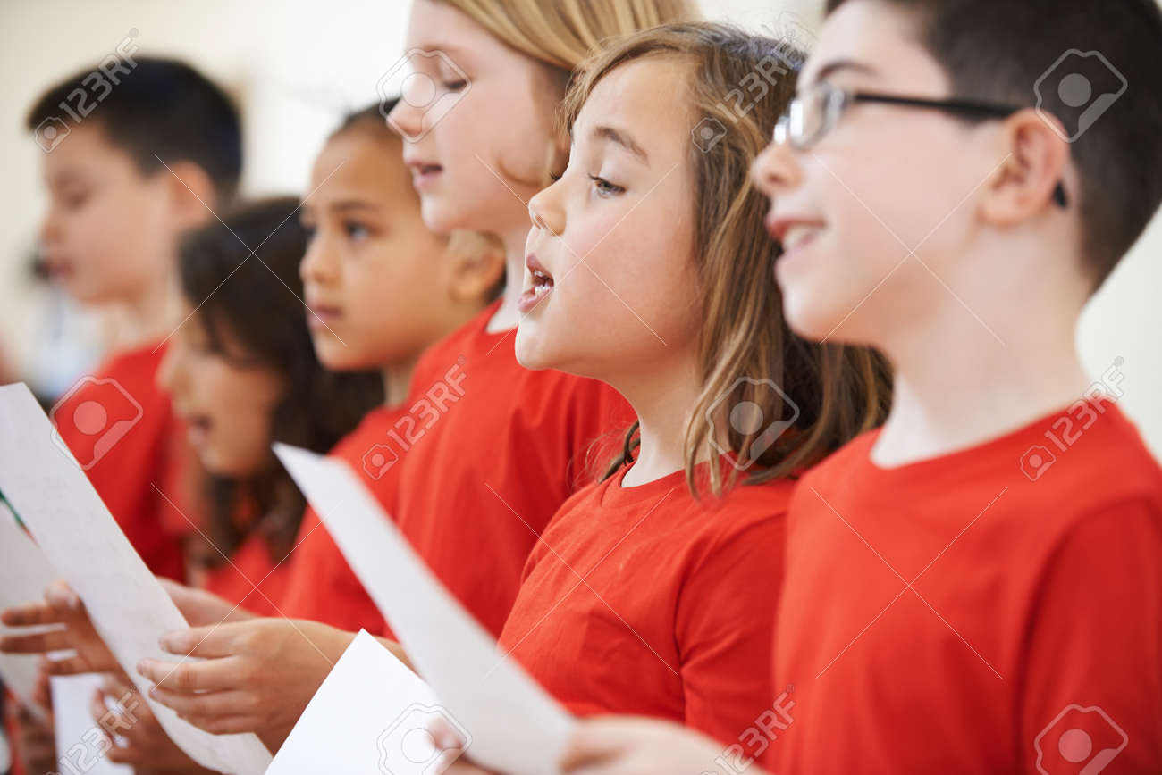 Group Of School Children Singing In Choir Together - 64626267
