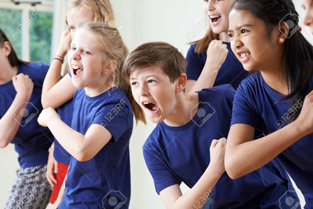 Group Of Children Enjoying Drama Class Together - 58983973