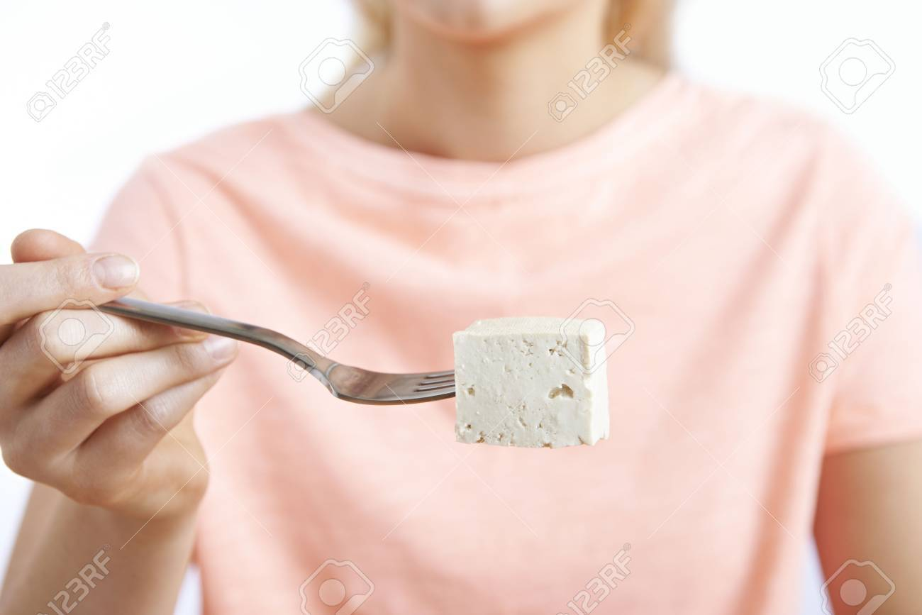 Close Up Of Woman With Tofu On Fork - 61521364