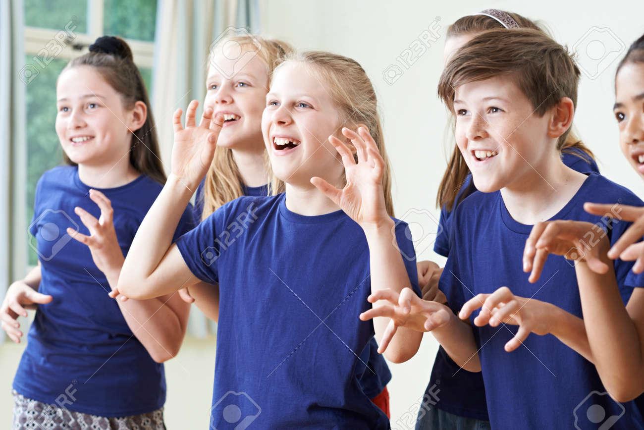 Group Of Children Enjoying Drama Class Together - 61521517