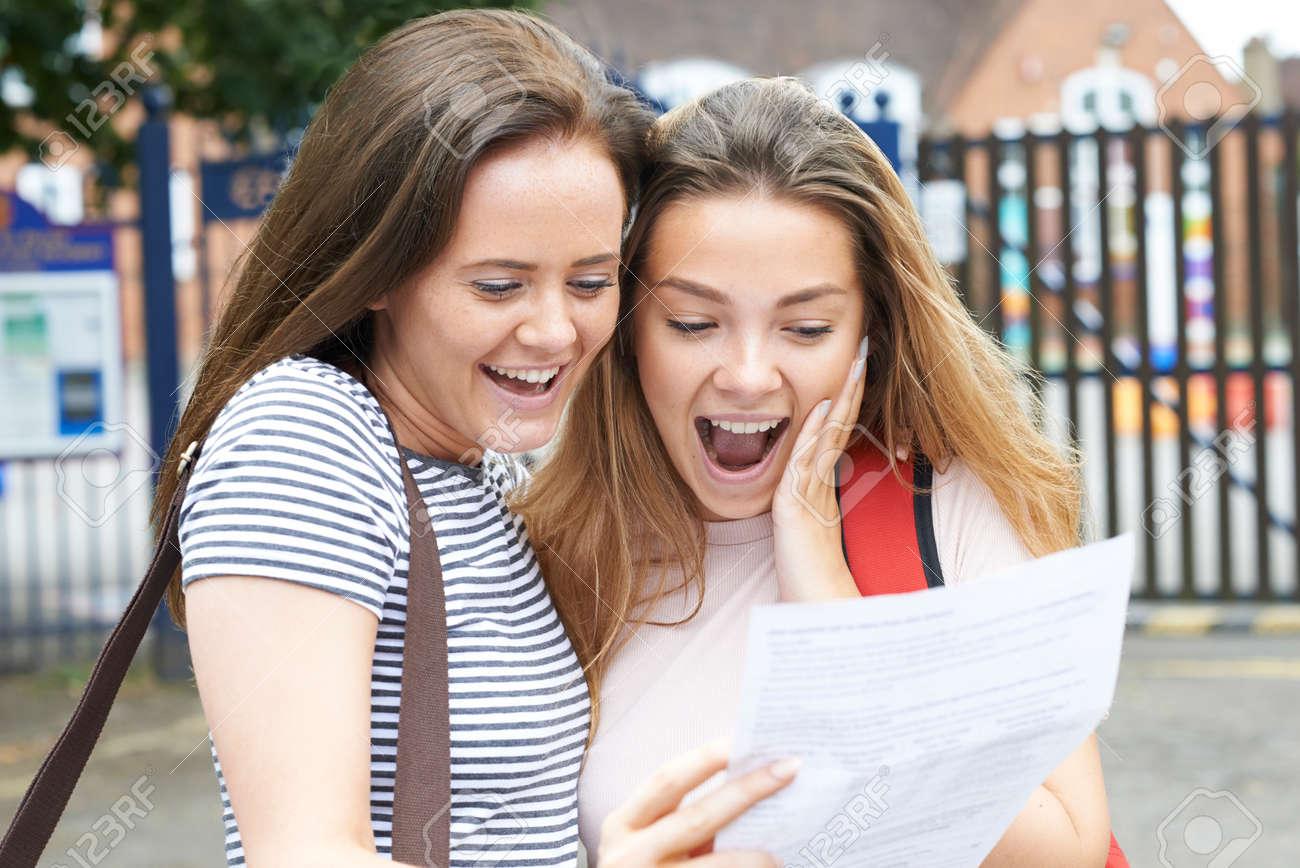 Teenage Girls Celebrating Exam Results - 63089823