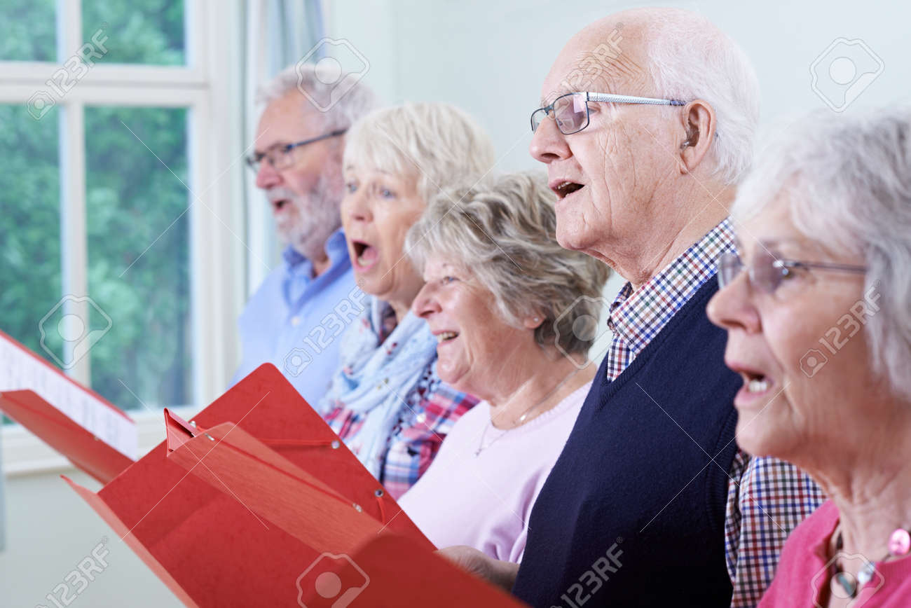 Group Of Seniors Singing In Choir Together - 63089846