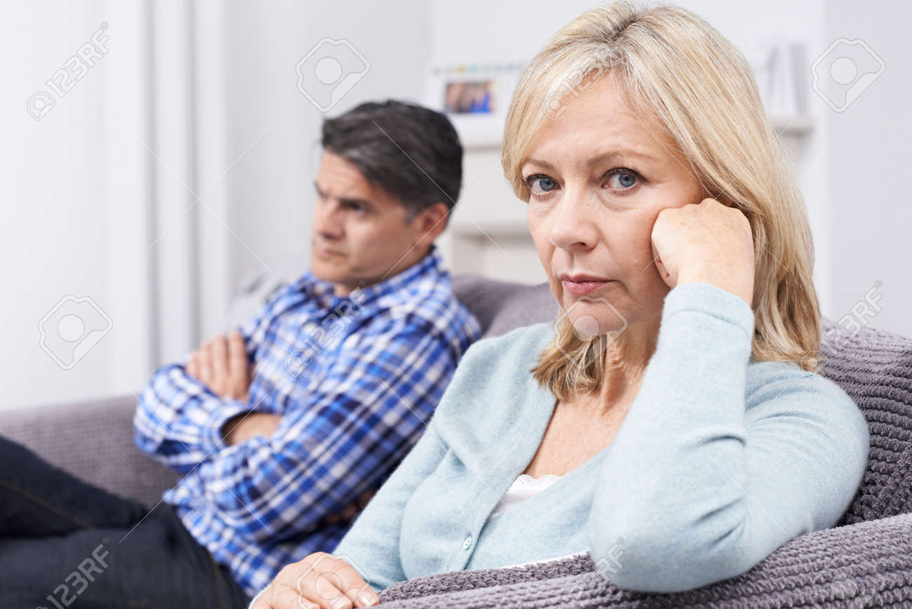Mature Couple With Relationship Difficulties Sitting On Sofa - 65715862